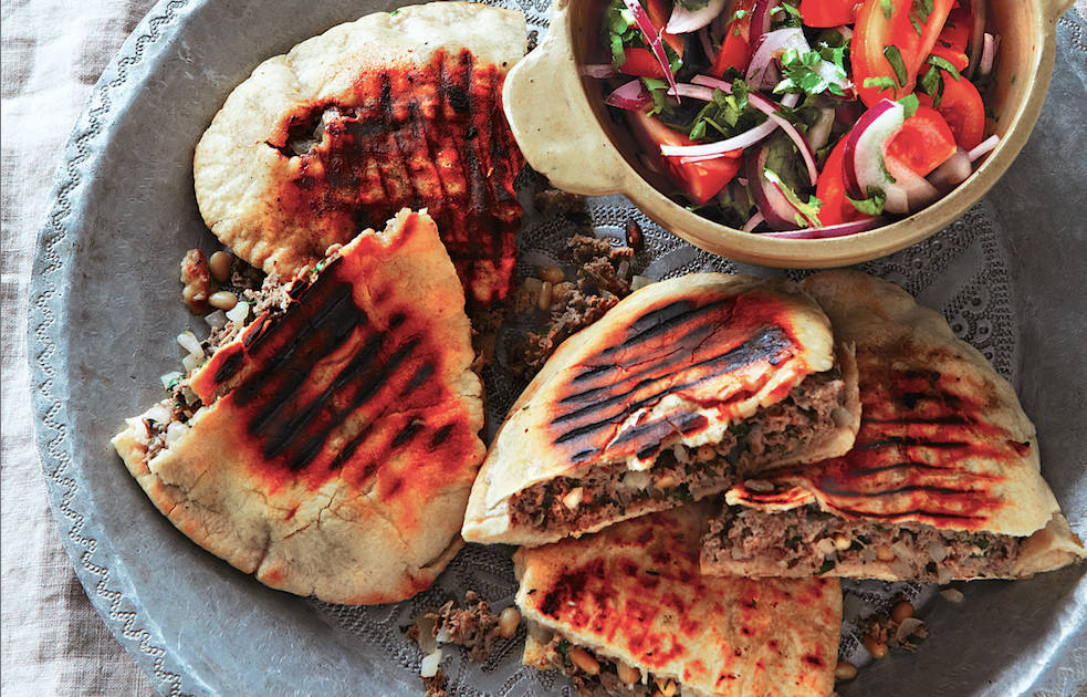 Our 20 favorite middle eastern recipes of all time food republic recipe spiced lamb in toasted pita with tomato amp red onion salad forumfinder Images