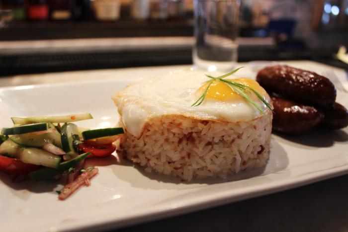 Maharlika's longsilog: garlic rice topped with a fried egg served with sweet garlic pork sausage and relish.