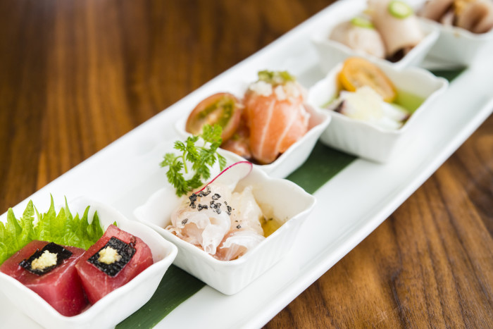 Sushi Roku's signature sashimi sampler features six creative spins on raw fish. (Photo courtesy of Sushi Roku.)