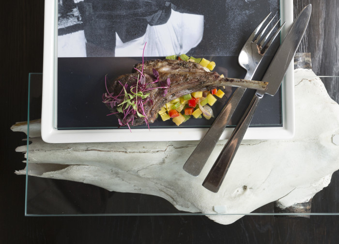 """Local artist Larry Swan created ceramic trays and glass and cow skull platters for """"O'Keeffe's Table"""" at Eloisa in Santa Fe. (Photo credit: Gabriella Marks Photography)"""