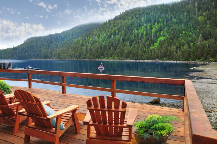 Unwind with a drink on the deck overlooking the bay. (Photo credit: Steamboat Bay Fishing Club)