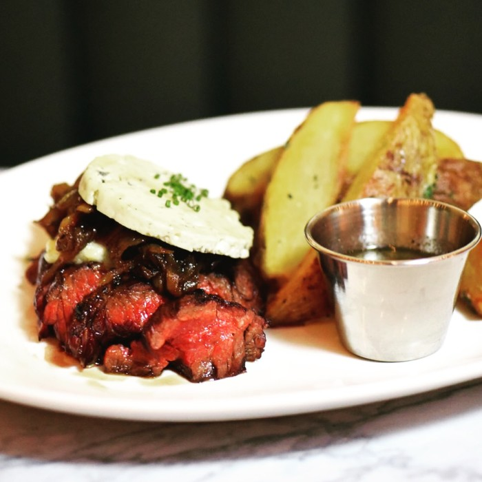 At Syndicated, you can go for the movies and stay for the steak frites.
