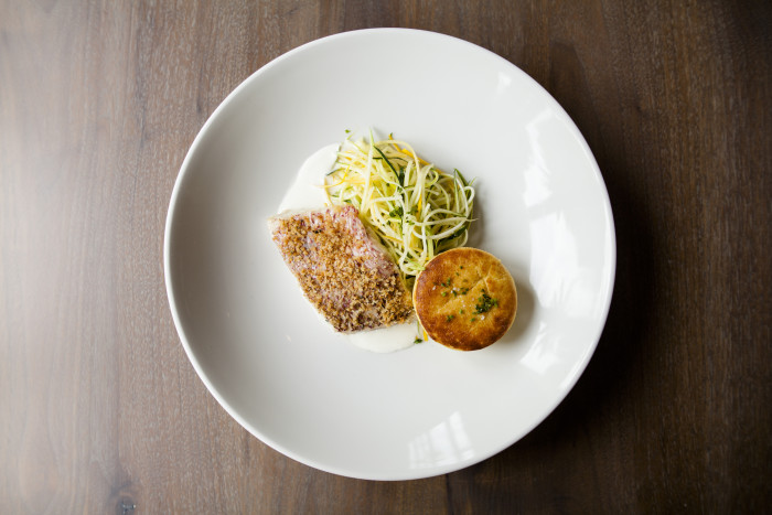 """Chef Dominic Rice's local red snapper is accompanied by zucchini """"noodles"""" and a creamy spoon bread. (Photo credit: SLATE)"""