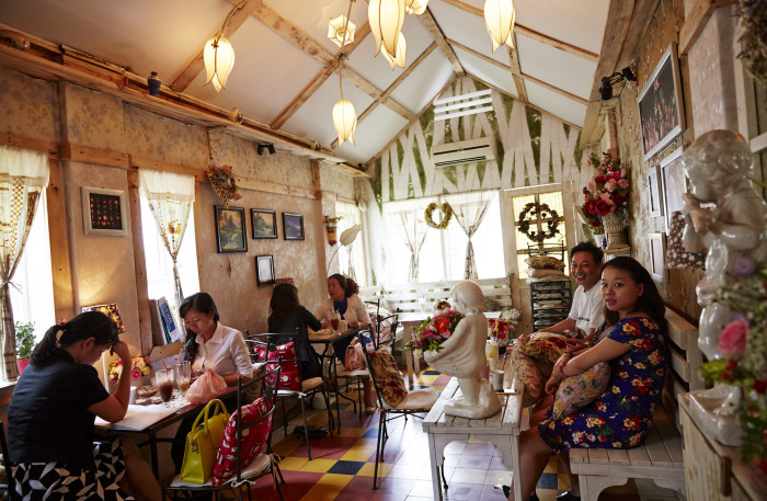 Gac Hoa Café is situated above a flower shop and it shows.