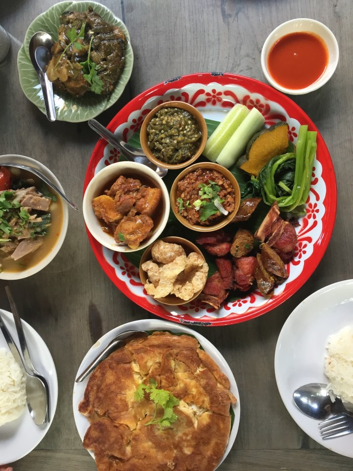 A platter of northern Thai specialties: nam prik noom, pork rinds, and sai oua.