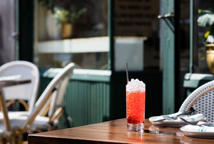 The Unlikely Negroni: a frappé served on crushed ice with fresh pressed orange juice, a mezcal-based version with a little cold brew coffee.