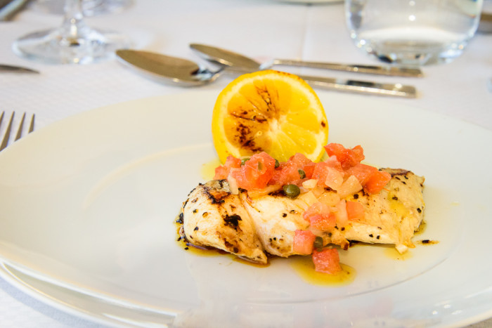 Chef Michel Nischan created several special dishes, like this one featuring a pan-seared filet of local white fish, dressed with lemon, tomatoes, capers, and olive oil. (Photo credit: Steve Schimmelman)
