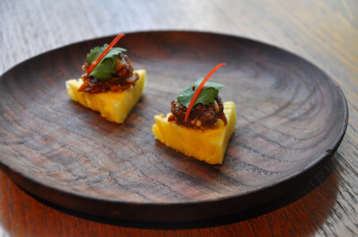 Prik chee fah is paired with pineapple in this Thai dish.