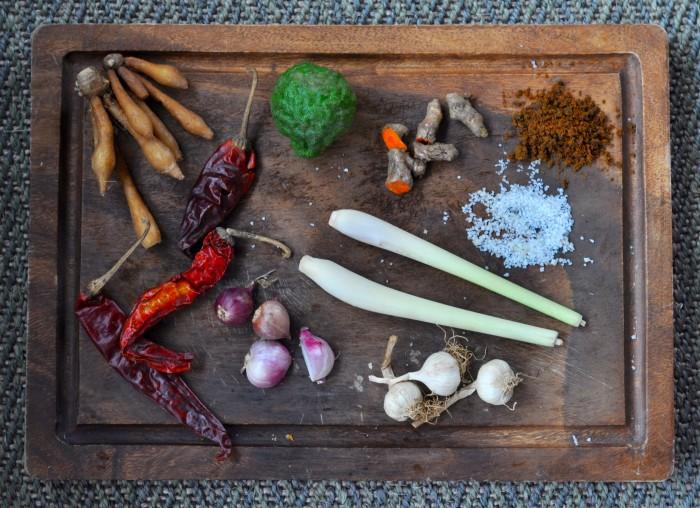 Khao soi curry paste ingredients: big dried chili, garlic, shallots kaffir lime, turmeric, fingerroot, lemongrass, shrimp paste, salt, curry powder.