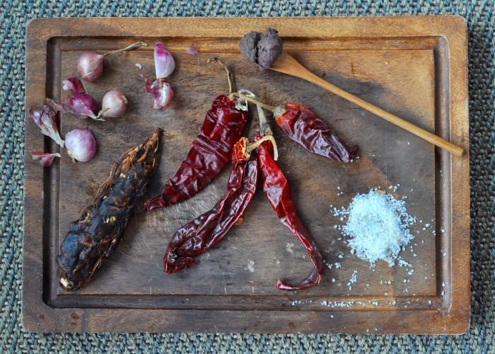 Orange curry ingredients: big dried chili, shallots, shrimp paste, dried tamarind, salt