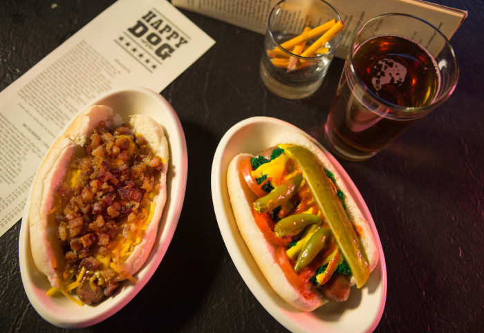 At Happy Dog, there's 50 toppings (such as SpaghettiOs, Froot Loops, and chunky peanut butter) for your hot dogs. (Photo credit: Happy Dog)