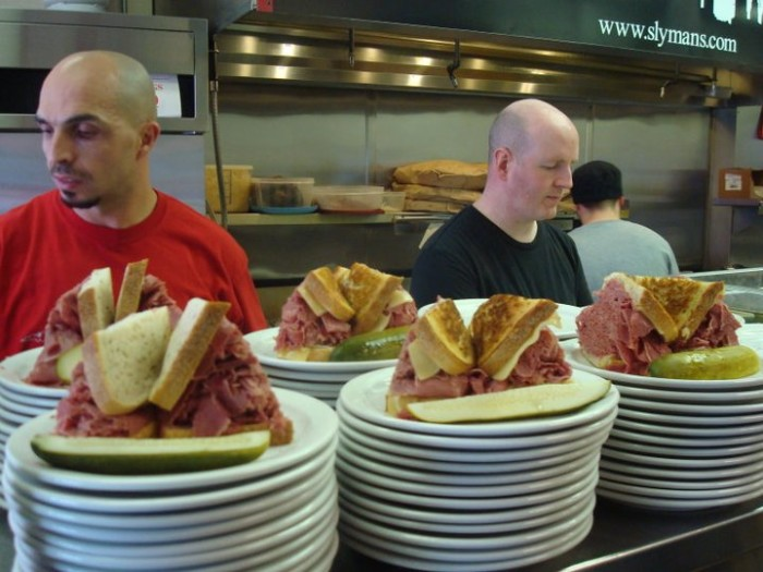 For over 50 years, this humble, family-owned deli has been slinging the city's best (and biggest) corned beef sandwiches. (Photo credit: Slyman's)