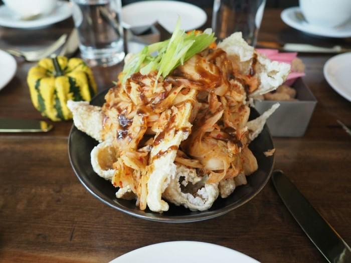 Kingsley's bar menu is home to their chicharrones. (Photo: Peter Nguyen.)