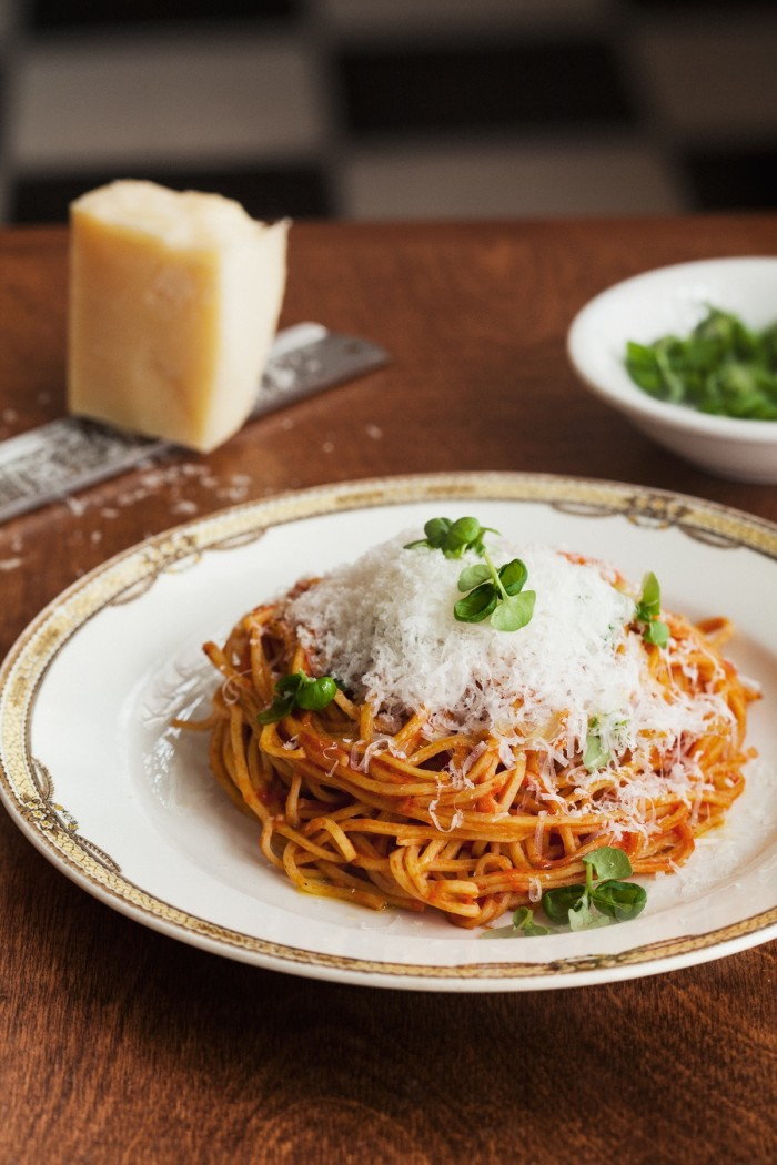 Spaghetti at Ask for Luigi comes piping hot and with a mountain of freshly grated parmesan. (Photo: Christopher Flett.)