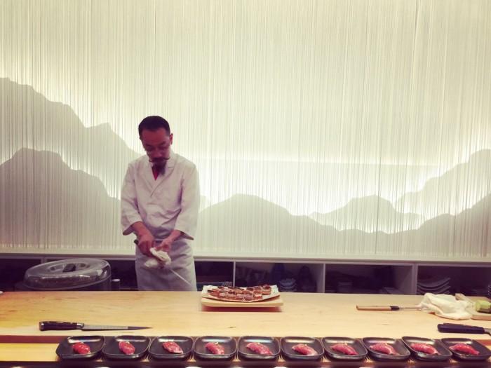 Sushi chef Christ Kinjo shows off his knife skills at MF Sushi. (Photo: Mai Pham.)