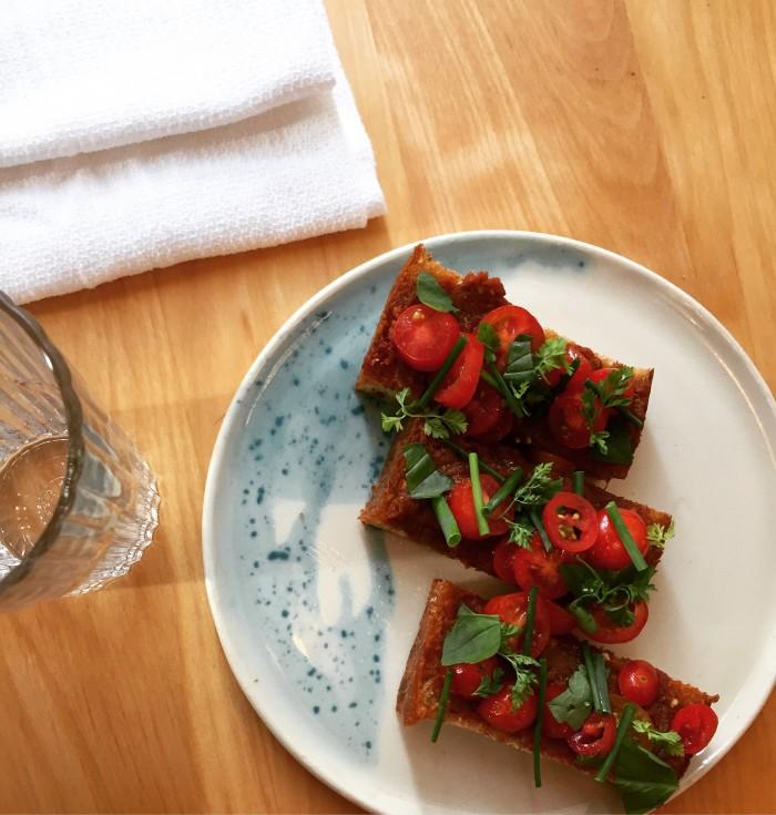Theodore Rex's tomato toast is halfway between Italian bruschetta and Catalan pa amb tomaquet. (Photo: Justin Yu.)